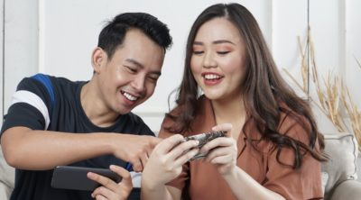 man and woman looking at phone screen